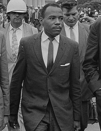 James Meredith walks to class at the University of Mississippi accompanied by U.S. Marshals