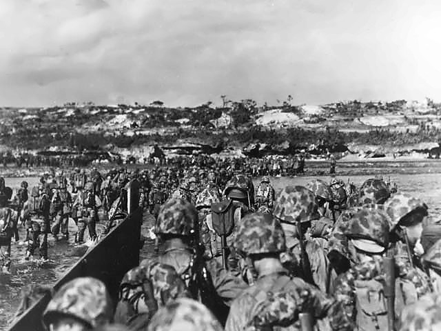 U.S. Marine reinforcements wade ashore to support the beachhead on Okinawa, March 31, 1945