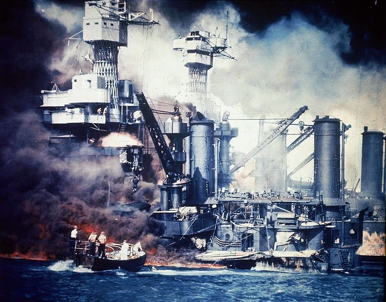 U.S. Navy sailors in a motor launch rescue a survivor from the water alongside the sunken battleship USS West Virginia (BB-48) during or shortly after the Japanese air raid