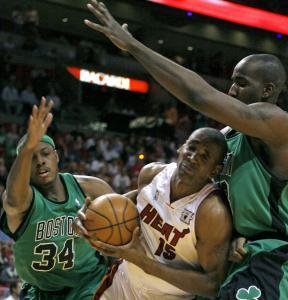 Miami's Mark Blount found it a little tough to maneuver as he tried to squeeze past Paul Pierce (34) and Kendrick Perkins.