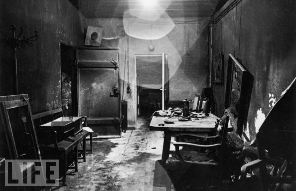 A new view of a photograph that appeared, heavily cropped, in LIFE of Hitler's command center in the bunker, partially burned by retreating German troops and stripped of valuables by invading Russians.