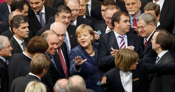 Chancellor Angela Merkel of Germany and members of the lower house of Parliament on Wednesday during a critical vote that enabled a subsequent deal to prop up the ailing euro.