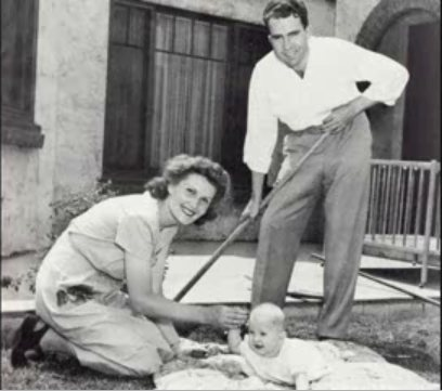 It's Richard and Pat Nixon with their first daughter, Tricia.