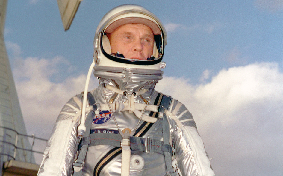 Astronaut John H. Glenn Jr. in his silver Mercury spacesuit during pre- flight training activities at Cape Canaveral.