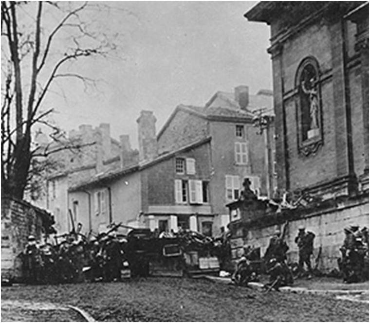 Soldiers of the 353rd Infantry near a church at Stenay, Meuse in France, wait for the end of hostilities.  This photo was taken at 10:58 a.m., on November 11, 1918, two minutes before the armistice ending World War I went into effect