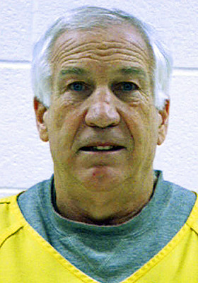 Jerry Sandusky was silent at his hearing before being booked on new sex abuse charges.