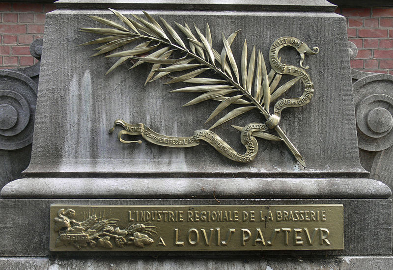 Bronze plaque on the foot of the facade of the Pasteur Institute Building of Lille in Northern France