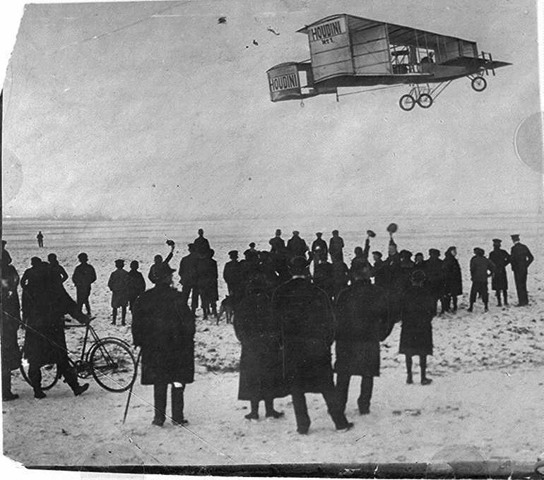 Pictures from Houdini's flight at Digger's Rest. Houdini's name is visible on the side of the plane.