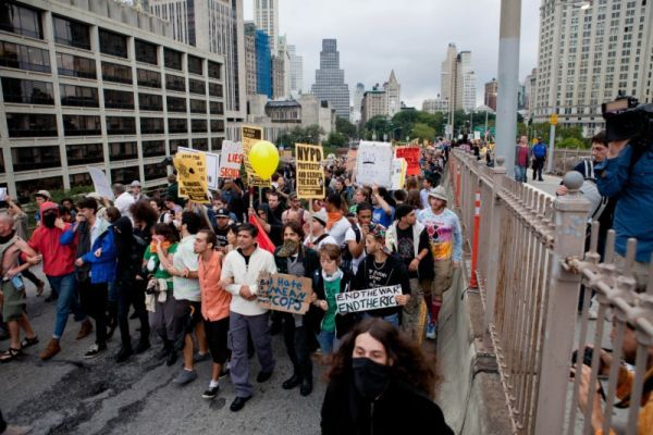 A large group of protesters affiliated with the Occupy Wall Street movement march across the Brooklyn Bridge, effectively shutting parts of it down, Saturday, Oct. 1, 2011 in New York.