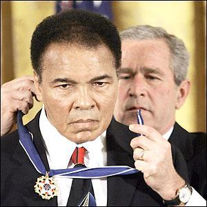 "Muhammad Ali, his hands shaking and eyes reflecting the White House chandeliers, accepted the nation's highest civilian award from President Bush on Wednesday. Bush called him ""the Greatest of All Time"" and ""a man of peace,"""