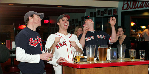 Decked out in Red Sox gear to celebrate Opening Day at Kings bowling alley in Boston were, from left, Seamus Donnelly, Paul McCann, and Sean Cullinane. Fans flocked to bars around town to watch the Sox first game.