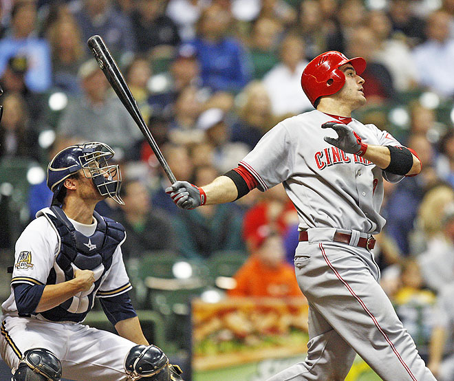 Joey Votto hits a two-run homer off Kameron Loe in the eighth inning at Miller Park.