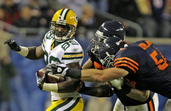 James Jones gets the ball stripped by Brian Urlacher.