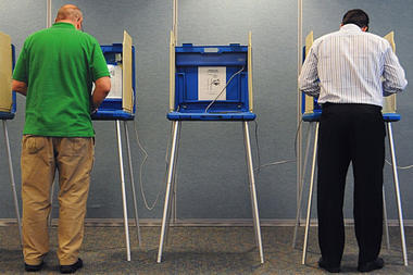 Two men cast their votes for the 32nd Senate District recall election Tuesday, Aug. 9, 2011, in Onalaska, Wis.