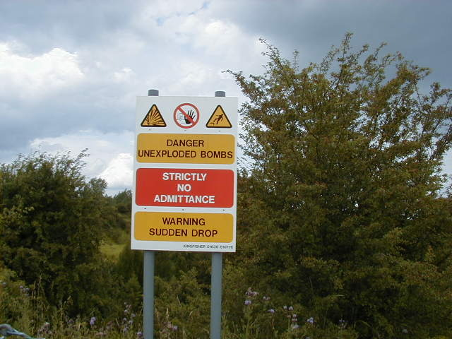 Warning sign at the edge of the crater made by the RAF Fauld explosion.