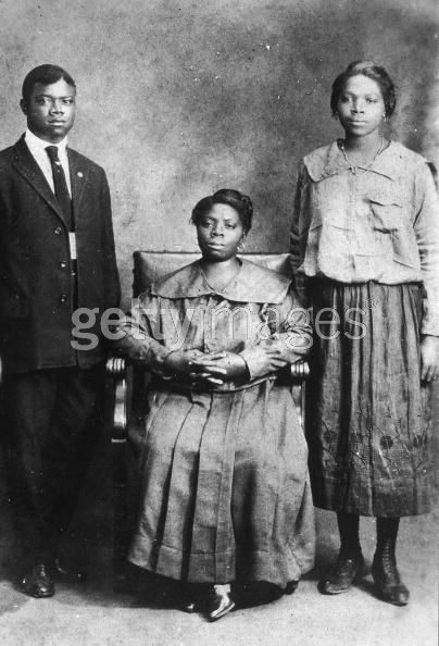 Portrait Of Louis Armstrong With Mother And Sister, 1918.