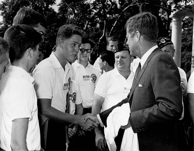 Bill Clinton shaking hands with President Kennedy on July 24, 1963 in the Rose Garden of the White House. He was in Washington, D.C. as a delegate from Arkansas to the Boys Nation Convention.