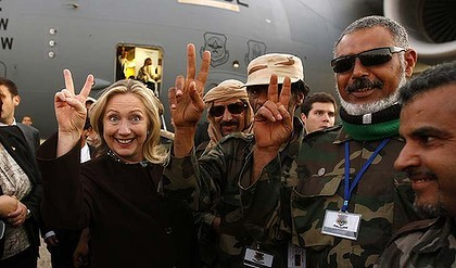V is for victory … Hillary Clinton with Libyan militia in Tripoli.