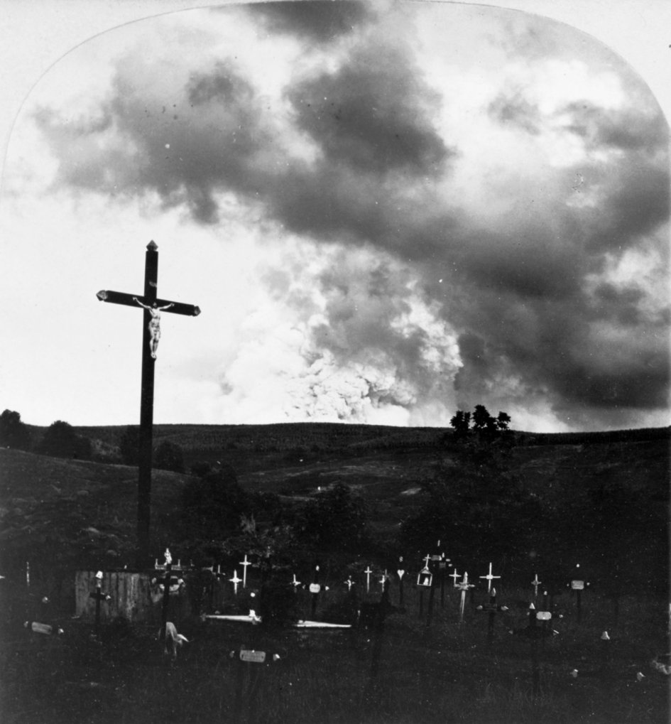 Eruption of Mount Pelée, Martinique, in 1902, with graveyard in foreground.