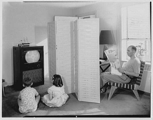 Father Reading Newspaper, Two Children Viewing Television