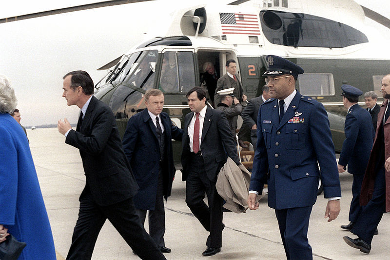 At the end of the Iran hostage crisis, Vice President George H. W. Bush and other VIPs wait to welcome hostages home