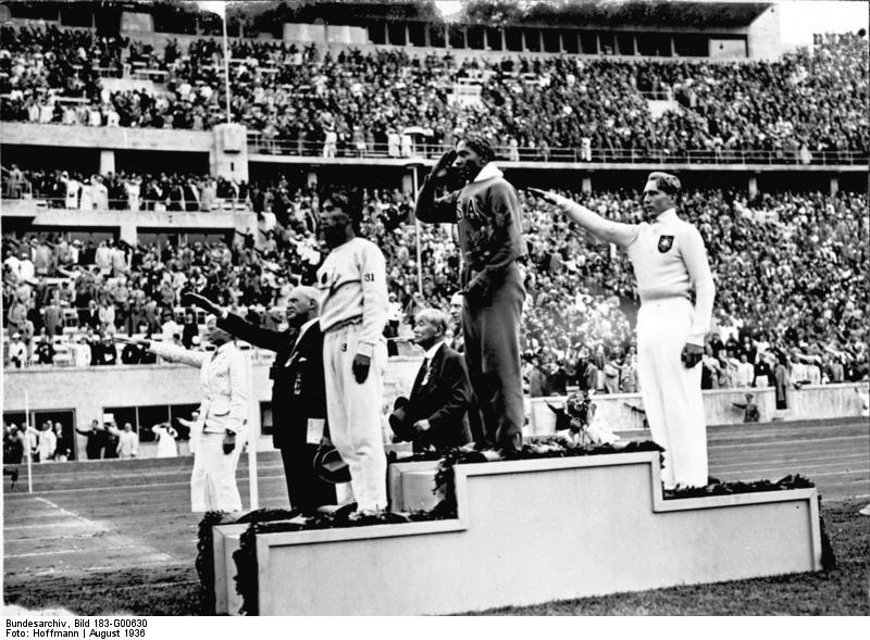 Jesse Owens on the podium after winning the long jump at the 1936 Summer Olympics