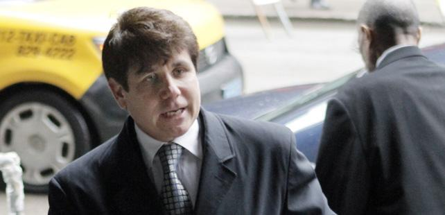 Former Gov. Rod Blagojevich arrives at federal court before taking the stand in his corruption retrial, Thursday, May 26, 2011.