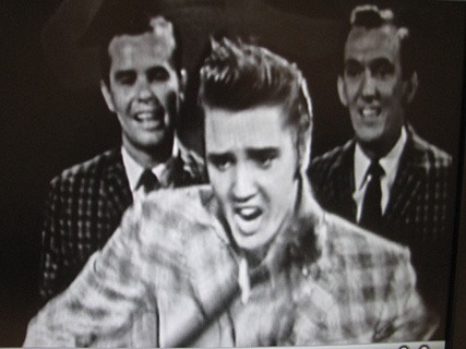 Photograph of Elvis Presley performing 'Reddy Teddy' on the Ed Sullivan Show