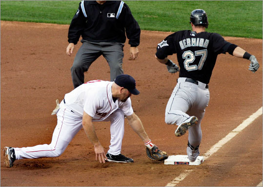 Kevin Youkilis tagged the bag to get the Marlins' Jeremy Hermida out on an infield ground ball during the first inning.