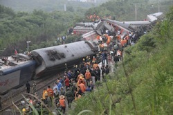 Rescue workers at the site of a derailed train in Dongxiang County.