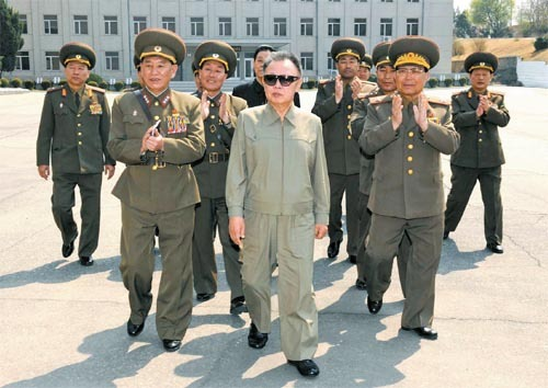North Korean leader Kim Jong-il, center, visits Army Unit 586 on Sunday, the 78th anniversary of the founding of the North's armed forces. Kim was received by Lt. Gen. Kim Yong-chol, front left, head of the reconnaissance bureau